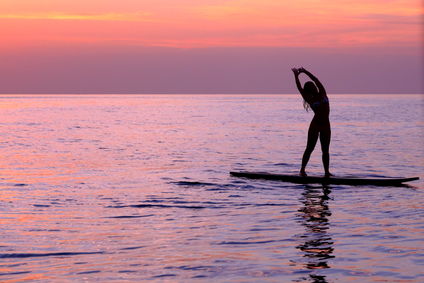 Woman doing sup yoga
