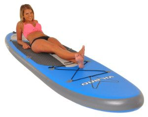 woman lying on vilano paddle board