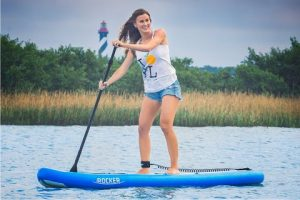 female paddling irocker sup on lake