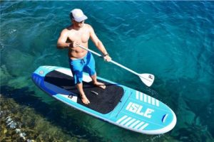 man paddling on isle airtech sup