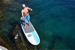 man paddling on isle versa epoxy sup