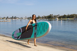 woman carrying isle peak paddleboard