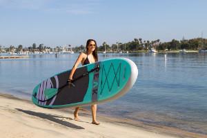 woman carrying isle peak paddleboard