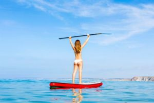 woman exercising on sup