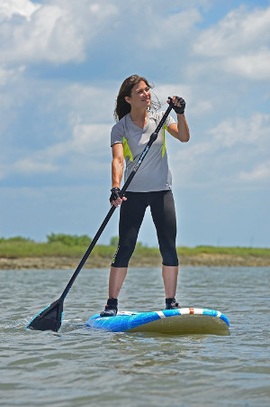 woman on california co paddle board
