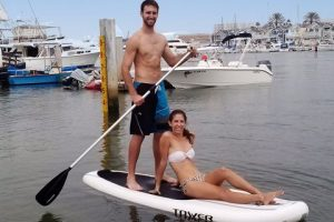 young couple paddling tower adventurer sup
