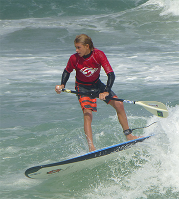 Teenage Boy Surfing on Liquid Shredder Paddle Board