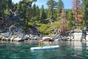 woman doing yoga on Isle Airtech paddle board