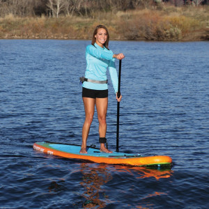 women paddling on Sportstuff paddle board