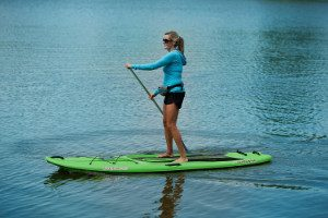 women paddling on Sun Dolphin Seaquest paddle board