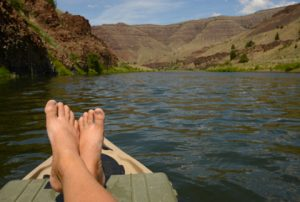 relaxing-on-a-SUP-in-a-beautiful-landscape