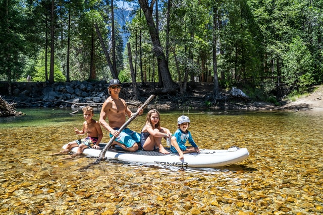 children on SUP with Father