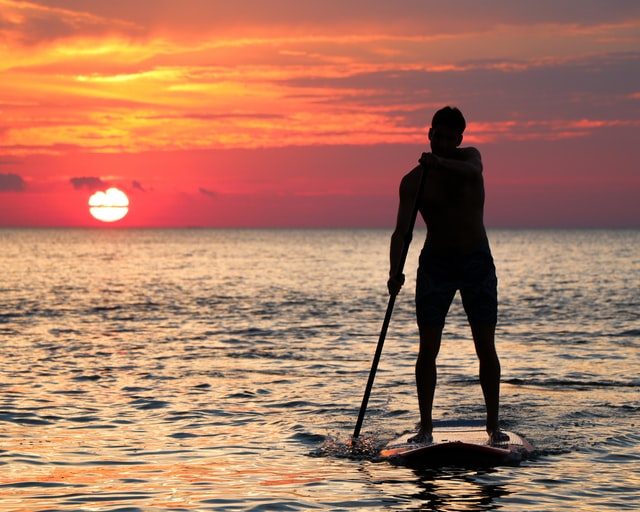 hard stand up paddle board in amazing sunset