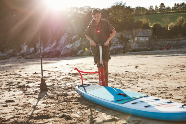Red Paddle Co Child inflating Paddle board